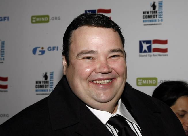 In this Wednesday, Nov 5, 2008, file photo, John Pinette arrives to the 2nd annual Stand Up For Heroes: A Benefit for the Bob Woodruff Foundation in New York.