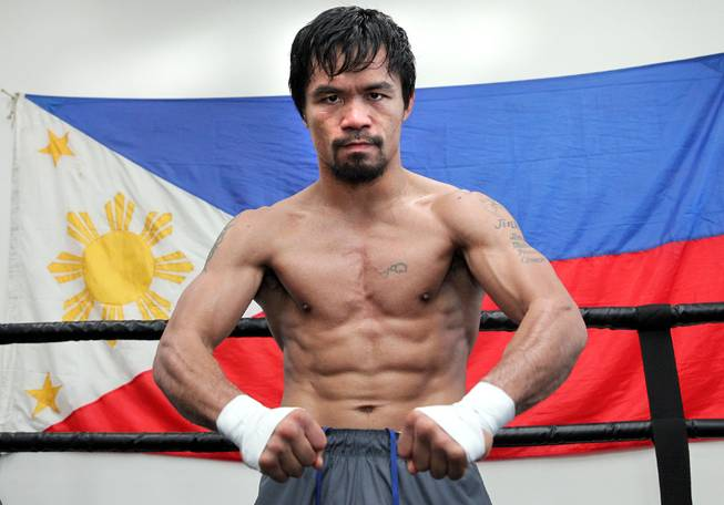 Manny Pacquiao works out at the Wild Card Boxing Club in Hollywood, Calif., during the final day of training camp Monday, April 7, 2014, before heading to Las Vegas for his eagerly anticipated rematch against undefeated WBO World Welterweight champion Timothy Bradley.