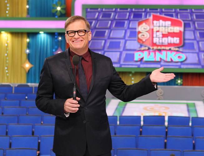 "This 2013 photo released by CBS shows Drew Carey, host of ""The Price Is Right,"" on the set in Los Angeles."