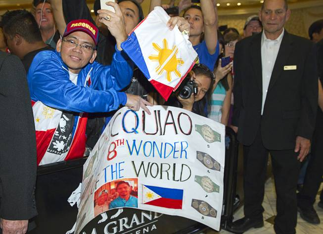 A fan waits for boxer Manny Pacquiao of the Philippines at the MGM Grand Tuesday, April 8, 2014. Pacquiao will challenge undefeated WBO welterweight champion Timothy Bradley at the MGM Grand Garden Arena on Saturday. The fight is a rematch to a June 9, 2012 fight that Bradley won.