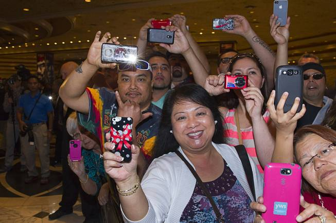 Fans wait for boxer Manny Pacquiao of the Philippines at the MGM Grand Tuesday, April 8, 2014. Pacquiao will challenge undefeated WBO welterweight champion Timothy Bradley at the MGM Grand Garden Arena on Saturday. The fight is a rematch to a June 9, 2012 fight that Bradley won.