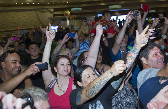 Fans try to get photos of boxer Manny Pacquiao of the Philippines at the MGM Grand Tuesday, April 8, 2014. Pacquiao will challenge undefeated WBO welterweight champion Timothy Bradley at the MGM Grand Garden Arena on Saturday. The fight is a rematch to a June 9, 2012 fight that Bradley won.