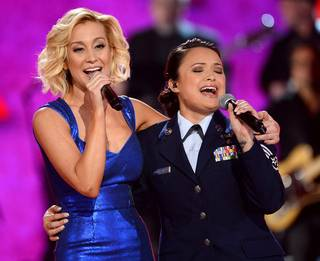 "Kellie Pickler and Staff Sgt. Baily Zimmerman perform during ""ACM Presents: All-Star Salute to the Troops"" at MGM Grand Garden Arena on Monday, April 7, 2014, in Las Vegas."
