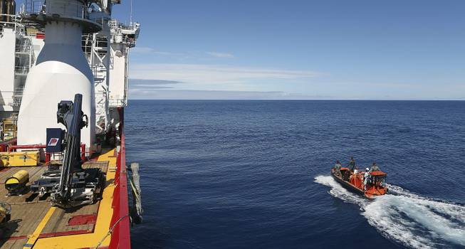 In this April 7, 2014, photo provided by the Australian Defense Force a fast response craft manned by members of the Australian Defense's ship Ocean Shield is deployed to scan the water for debris of the missing Malaysia Airlines Flight 370 in the southern Indian Ocean.