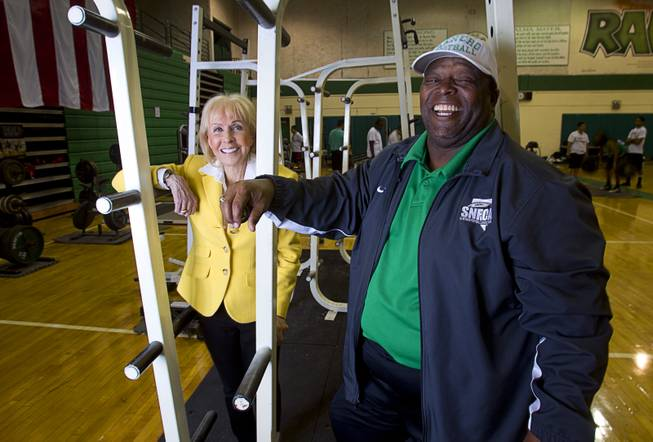 Susan Spencer, former general manager of the Philadelphia Eagles, poses with football coach Tyrone Armstrong at Rancho High School Monday, April 7, 2014. Spencer's nonprofit A Level Playing Field has given more than $30,000 of equipment and funds to the Rancho HS football team.