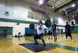 Brian Arcadia lifts weights at Rancho High School Monday, April 7, 2014. Susan Spencer's nonprofit A Level Playing Field has given more than $30,000 of equipment and funds to the Rancho HS football team.
