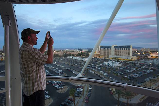 Shannon Fletcher of Rison, Ark. takes a photo while riding the 550 foot-tall High Roller observation wheel, the tallest in the world, Wednesday, April 9, 2014. The wheel is the centerpiece of the $550 million Linq project, a retail, dining and entertainment district by Caesars Entertainment Corp.