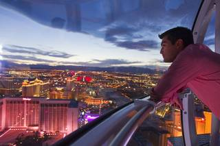 Alejandro Higuera of Mexico rides the 550 foot-tall High Roller observation wheel, the tallest in the world, Wednesday, April 9, 2014. The wheel is the centerpiece of the $550 million Linq project, a retail, dining and entertainment district by Caesars Entertainment Corp.