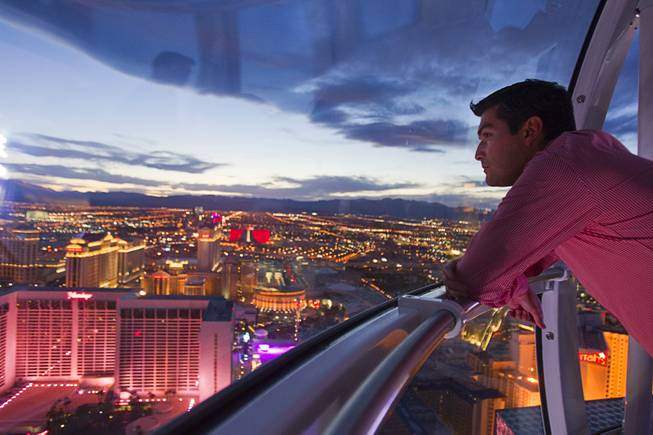 Alejandro Higuera of Mexico rides the 550 foot-tall High Roller observation wheel, the tallest in the world, Wednesday, April 9, 2014.