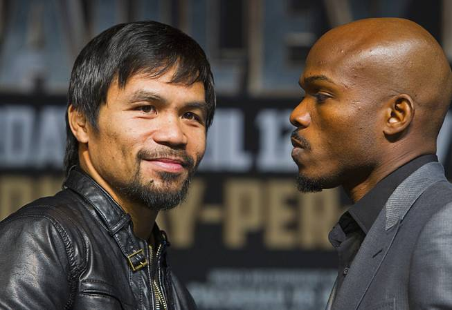 Boxer Manny Pacquiao, left, of the Philippines and undefeated WBO welterweight champion Timothy Bradley pose during a news conference at the MGM Grand Wednesday, April 9, 2014. Pacquiao will challenge Bradley at the MGM Grand Garden Arena on Saturday. The fight is a rematch to a June 9, 2012 fight that Bradley won.