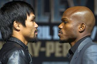 Boxer Manny Pacquiao, left, of the Philippines and undefeated WBO welterweight champion Timothy Bradley face off during a news conference at the MGM Grand Wednesday, April 9, 2014. Pacquiao will challenge Bradley at the MGM Grand Garden Arena on Saturday. The fight is a rematch to a June 9, 2012 fight that Bradley won.
