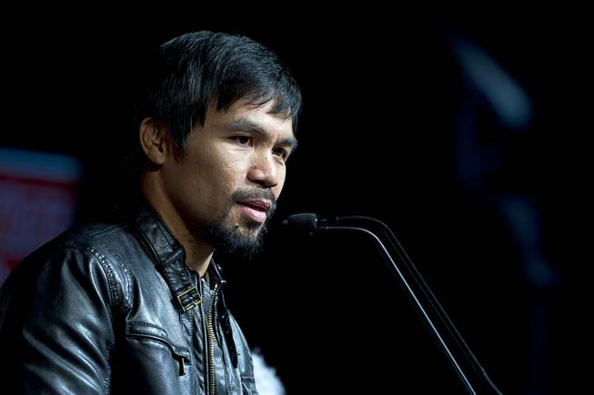 Boxer Manny Pacquiao of the Philippines speaks during a news conference at the MGM Grand Wednesday, April 9, 2014. Pacquiao will challenge undefeated WBO welterweight champion Timothy Bradley at the MGM Grand Garden Arena on Saturday. The fight is a rematch to a June 9, 2012 fight that Bradley won.