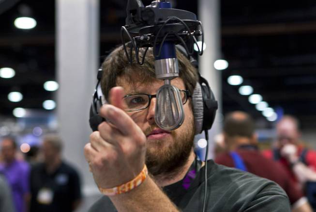 Thomas Cassetta checks out the sound quality of a Schoeps V4 studio/vocal microphone during the National Association of Broadcasters show on Tuesday, April 8, 2014.