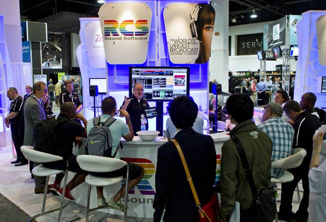 Barry Hills introduces attendees to RCS Sound Software during the National Association of Broadcasters show at the Las Vegas Convention Center on Tuesday, April 8, 2014.