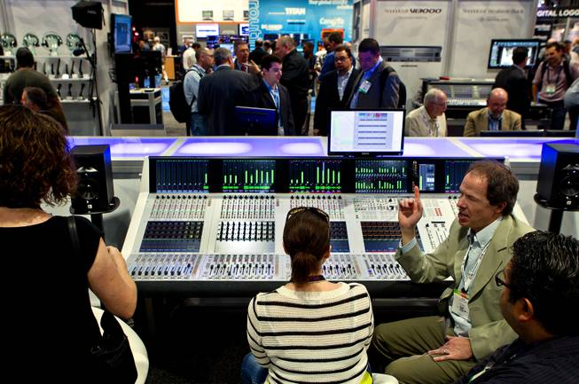 Rob Lewis introduces attendees to the Studer Infinity Series mixing board during the National Association of Broadcasters show at the Las Vegas Convention Center on Tuesday, April 8, 2014.