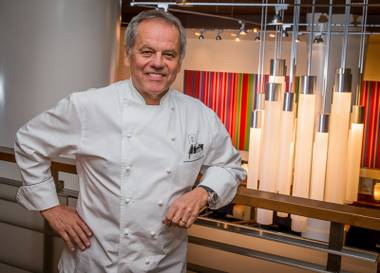 "Wolfgang Puck signs copies of his newly released cookbook ""Wolfgang Puck Makes It Healthy: Light, Delicious Recipes and Easy Exercises for a Better Life,"" on April 9 at his restaurant Spago at the Forum Shops."