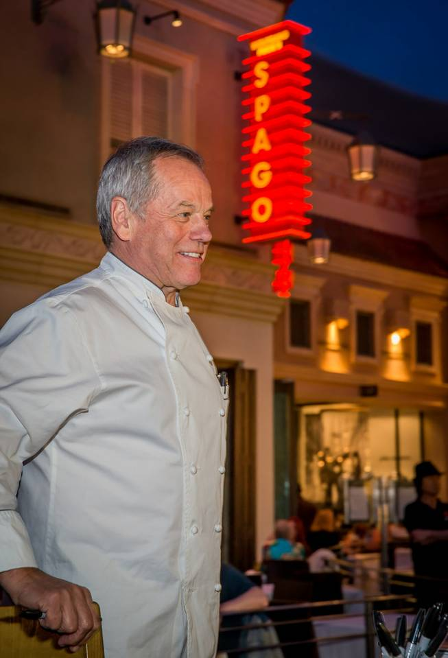 "Wolfgang Puck signs copies of his newly released cookbook ""Wolfgang Puck Makes It Healthy: Light, Delicious Recipes and Easy Exercises for a Better Life,"" on Wednesday,  April 9, 2014, in front of his restaurant Spago at the Forum Shops in Caesars Palace."