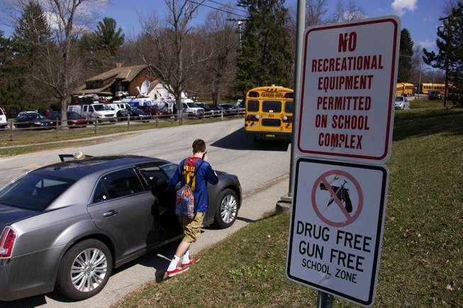 A student leaves the campus of the Franklin Regional School District where several people were stabbed at Franklin Regional High School on Wednesday, April 9, 2014, in Murrysville, Pa., near Pittsburgh. The suspect, a male student, was taken into custody and being questioned.
