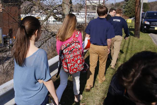 Students leave the campus of the Franklin Regional School District where several people were stabbed at Franklin Regional High School on Wednesday, April 9, 2014, in Murrysville, Pa., near Pittsburgh. The suspect, a male student, was taken into custody and being questioned.