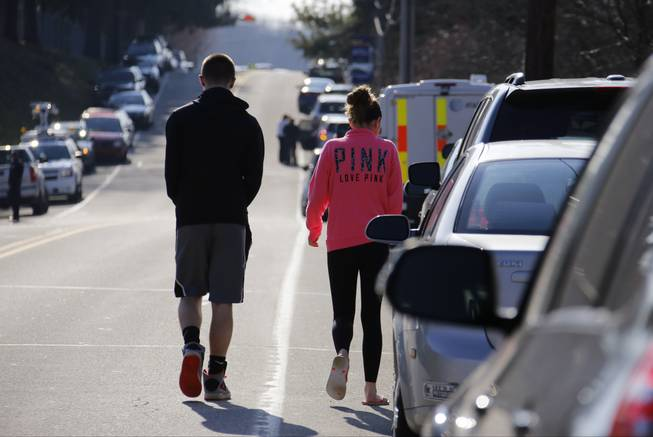 Studentswalk down the street away from the campus of the Franklin Regional School District, where several people were stabbed at Franklin Regional High School, on Wednesday, April 9, 2014, in Murrysville, Pa., near Pittsburgh. The suspect, a male student, was taken into custody and being questioned.
