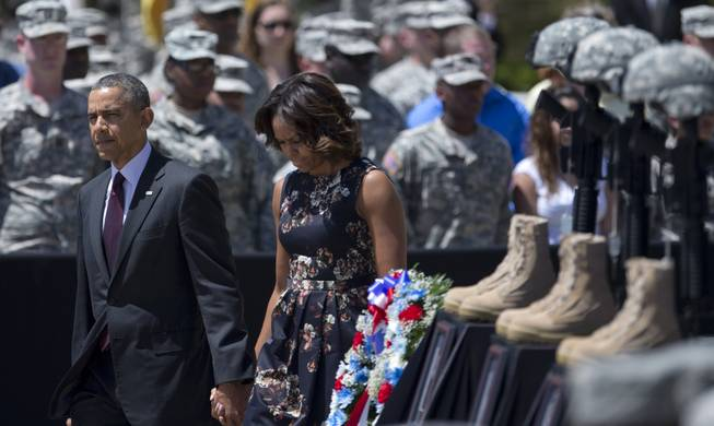 President Barack Obama and first lady Michelle Obama arrive for a memorial ceremony, Wednesday, April 9, 2014, at Fort Hood Texas, for those killed there in a shooting last week.
