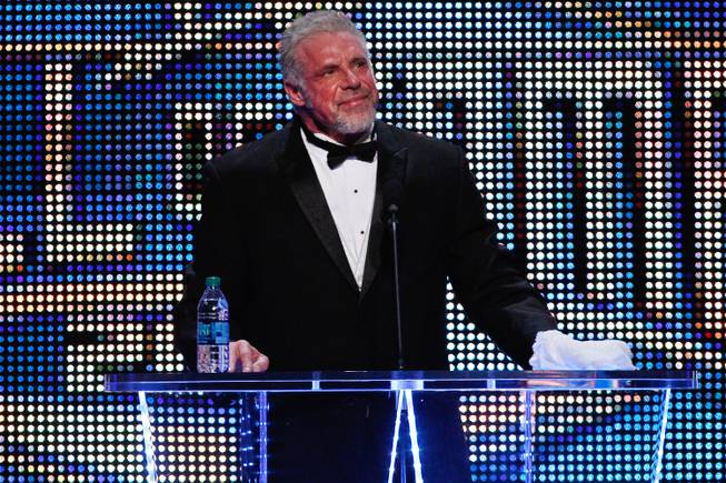 In this April 5, 2014, file photo provided by the WWE, James Hellwig, aka The Ultimate Warrior, speaks during the WWE Hall of Fame Induction at the Smoothie King Center in New Orleans.
