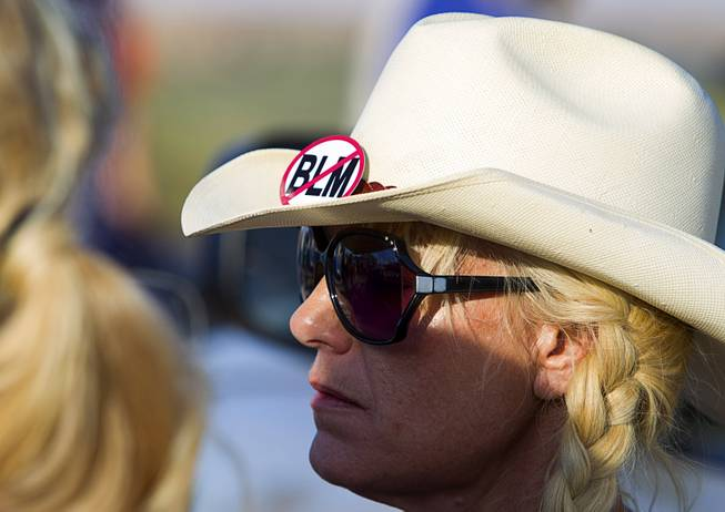 "A woman wears a ""No BLM"" button on her hat during a protest in support of the Bundy family near Bunkerville Thursday, April 10, 2014."