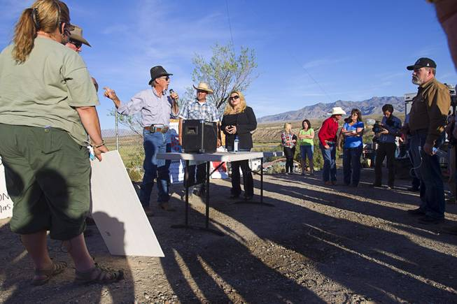 Charlie Childers of Logandale speaks during a protest in support of the Bundy family near Bunkerville Thursday, April 10, 2014. With Childers are Ammon Bundy, center, and State Assemblywoman Michele Fiore.