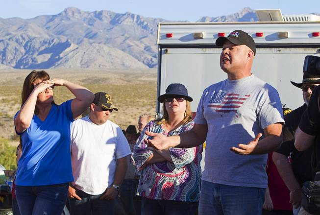 Peter Skreta, right, of Las Vegas, asks a question to State Assemblyman Cresent Hardy during a protest in support of the Bundy family near Bunkerville Thursday, April 10, 2014.