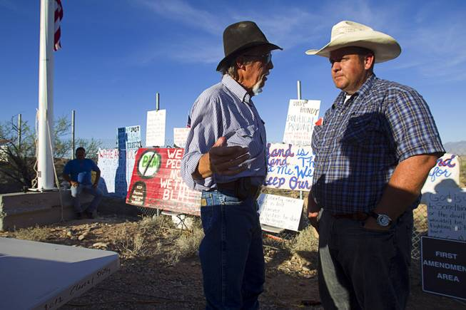 Charlie Childers, left, of Logandale speaks with Dave Bundy during a protest in support of the Bundy family near Bunkerville Thursday, April 10, 2014.