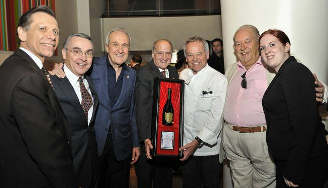 Wolfgang Puck, third from right, receives the UNLVino Dom Perignon Award of Excellence during Sip & Savor at his restaurant Spago on Wednesday, April 9, 2014, in the Forum Shops at Caesars Palace.