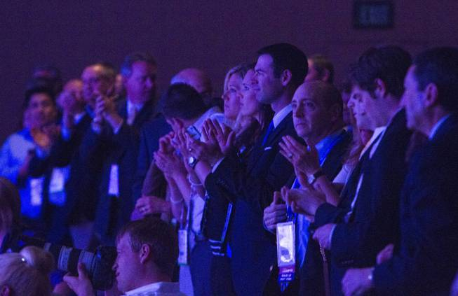 Members of the audience give an standing ovation as former U.S. Secretary of State Hillary Rodham Clinton continues with her speech after an object was thrown on stage at the Institute of Scrap Recycling Industries annual convention at the Mandalay Bay Convention Center Thursday, April 10, 2014.