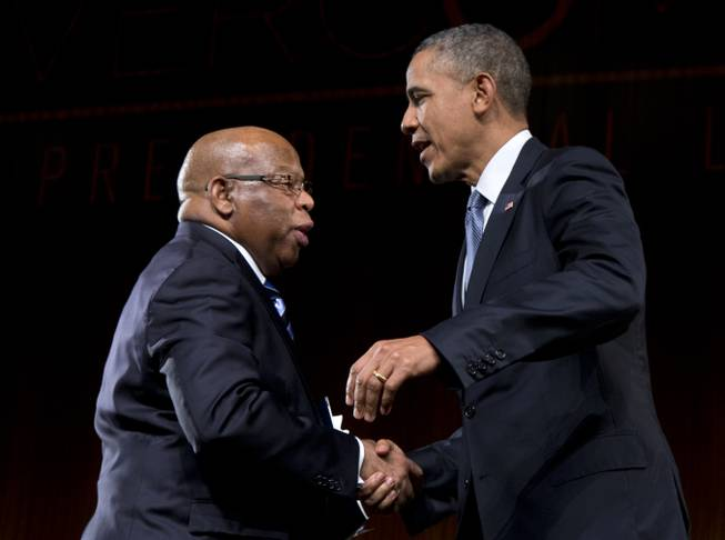 President Barack Obama is greeted by Rep. John Lewis, D-Ga., as he arrives to speak at the LBJ Presidential Library on Thursday, April 10, 2014, in Austin, Texas, during the Civil Rights Summit to commemorate the 50th anniversary of the signing of the Civil Rights Act. Lewis withstood violence and arrest during the Civil Rights marches through Alabama in the mid-1960s.