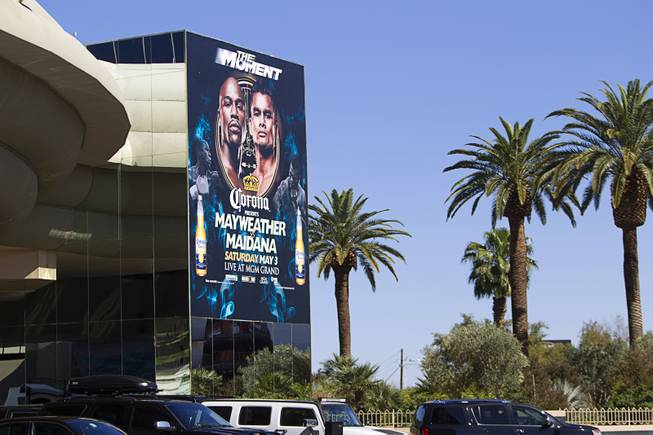 An advertisement for Floyd Mayweather Jr.'s upcoming fight is seen at the MGM Grand Thursday, April 10, 2014. Top Rank CEO Bob Arum, promoter for boxer Manny Pacquiao, voiced his displeasure at the Mayweather signage during a news conference on Wednesday.