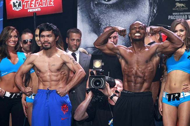 Boxer Manny Pacquiao, left, of the Philippines and undefeated WBO welterweight champion Timothy Bradley pose during an official weigh-in at the MGM Grand Garden Arena Friday, April 11, 2014. Pacquiao will challenge Bradley at the arena on Saturday. The fight is a rematch to a June 9, 2012 fight that Bradley won.