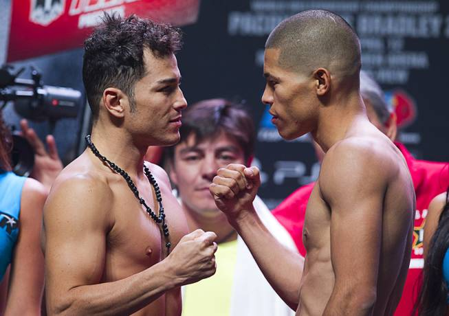 Super featherweight boxers Bryan Vazquez, left, of Costa Rica and Jose Felix of Mexico face off during an official weigh-in at the MGM Grand Garden Arena Friday, April 11, 2014. The boxers will fight for an WBA interim featherweight title.