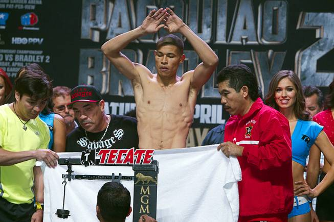 Super featherweight boxer Jose Felix of Mexico stands naked behind a towel during an official weigh-in at the MGM Grand Garden Arena Friday, April 11, 2014. Felix will fight Bryan Vazquez of Costa Rica for an WBA interim featherweight title at the arena on Saturday.