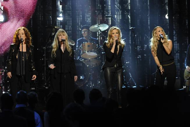 Bonnie Raitt, Stevie Nicks, Sheryl Crow, and Carrie Underwood perform at the 2014 Rock and Roll Hall of Fame Induction Ceremony on Thursday, April, 10, 2014 in New York.