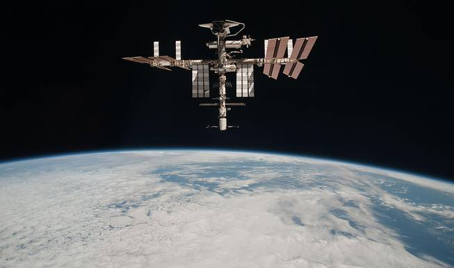 This May 23, 2011, photo shows the International Space Station at an altitude of approximately 220 miles above the Earth, taken by Expedition 27 crew member Paolo Nespoli from the Soyuz TMA-20 following its undocking.