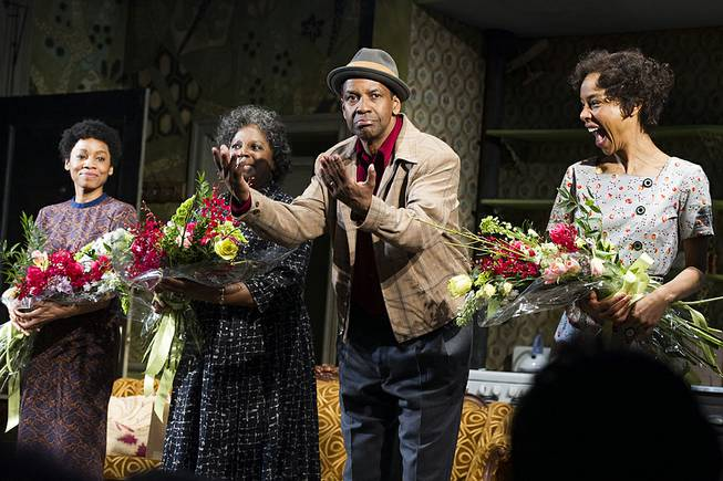 "Anika Noni Rose, from left, LaTanya Richardson, Denzel Washington and Sophie Okonedo are shown at the curtain call for the opening night of ""A Raisin in the Sun"" in New York, April 3, 2014."