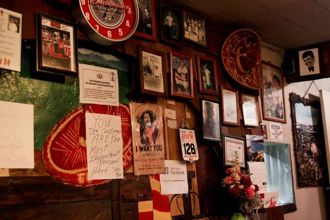 The interior decor on one of the walls at El Sombrero restaurant located on Main Street, which has been open since 1950, on its closing day Saturday, April 12, 2014.
