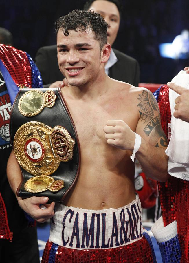 Bryan Vasquez of Costa Rica celebrates his unanimous decision over Jose Felix of Mexico in their WBA interim super featherweight fight at the MGM Grand Garden Arena on Saturday, April 12, 2014.