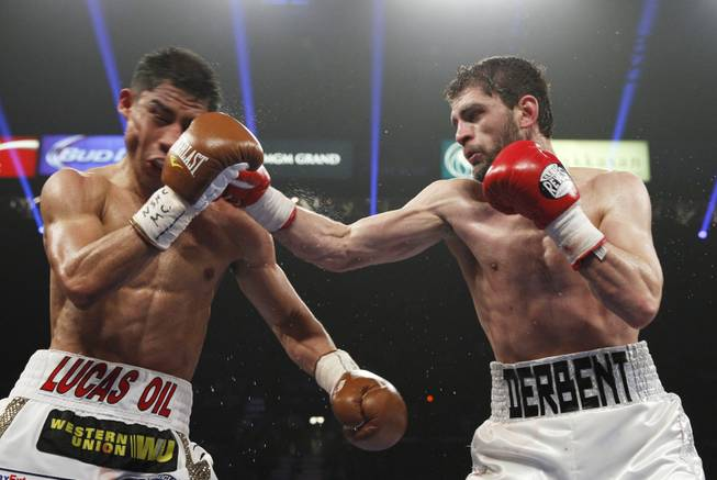 Jessie Vargas of Las Vegas is hit by Khabib Allakhverdiev of Russia during their WBA interim super lightweight fight at the MGM Grand Garden Arena on Saturday, April 12, 2014.