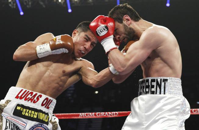 Jessie Vargas of Las Vegas hits Khabib Allakhverdiev of Russia with a left during their WBA interim super lightweight fight at the MGM Grand Garden Arena on Saturday, April 12, 2014.