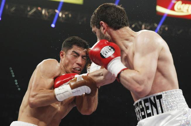 Jessie Vargas, left, is hit with a right by Khabib Allakhverdiev during their WBA interim super lightweight fight at the MGM Grand Garden Arena on Saturday, April 12, 2014.