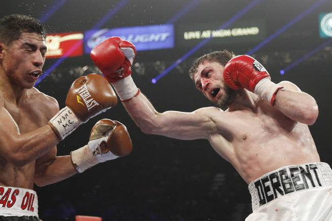 Jessie Vargas is hit by Khabib Allakhverdiev during their WBA interim super lightweight fight at the MGM Grand Garden Arena on Saturday, April 12, 2014.