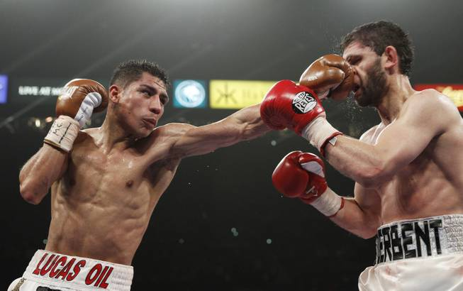 Jessie Vargas hits Khabib Allakhverdiev with a left during their WBA interim super lightweight fight at the MGM Grand Garden Arena on Saturday, April 12, 2014. Vargas won by unanimous decision.