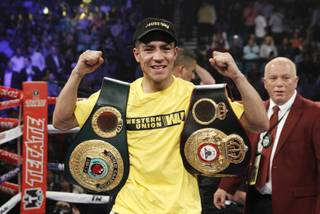 Jessie Vargas of Las Vegas celebrates his unanimous decision over Khabib Allakhverdiev of Russia after their WBA interim super lightweight fight at the MGM Grand Garden Arena on Saturday, April 12, 2014.