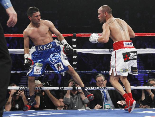 Arash Usmanee leaps away from Ray Beltran during a 10-round lightweight fight at the MGM Grand Garden Arena on Saturday, April 12, 2014.