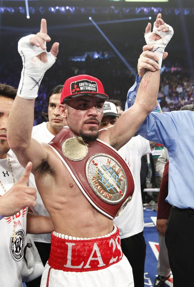 Ray Beltran of Mexico celebrates his unanimous victory over Arash Usmanee after their 12-round lightweight fight at the MGM Grand Garden Arena on Saturday, April 12, 2014.